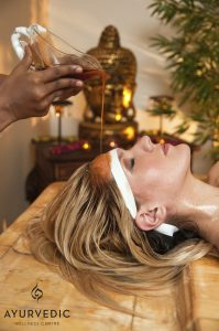 Shirodhara involves the a gentle stream of warm medicated oil onto the third eye and can be used to treat infertility. Experience it at the Ayurvedic Wellness Centre!
