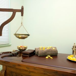 Ayurveda Massage Treatment table Ayurvedic Wellness Centre