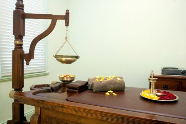 Ayurveda Massage Treatment table Ayurvedic Wellness Centre